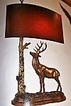 Deer Resin Table Lamp finished in Bronze with Hand Painted Leatherette Shade. 3-way. 29.5 H x 18 Reach