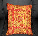 Needlepoint Pillow - various shades of Red and Yelow wi/ geometric design.